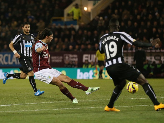 George Boyd of Burnley scores the opening goal during the Barclays Premier League match between Burnley and Newcastle United at Turf Moor on December 2, 2014