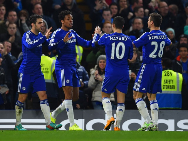 Loic Remy of Chelsea celebrates scoring their third goal with Cesc Fabregas, Eden Hazard and Cesar Azpilicueta of Chelsea during the Barclays Premier League match between Chelsea and Tottenham Hotspur at Stamford Bridge on December 3, 2014