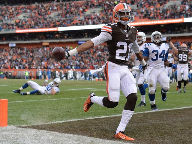 Justin Gilbert #21 of the Cleveland Browns returns an interception for a touchdown during the third quarter against the Indianapolis Colts at FirstEnergy Stadium on December 7, 2014