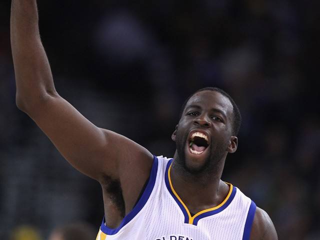Draymond Green #23 of the Golden State Warriors reacts after making a three-pointer against the Los Angeles Clippers at ORACLE Arena on November 5, 2014
