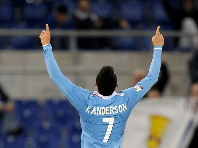 Felipe Anderson of SS Lazio celebrates after scoring the third team's goal during the TIM Cup match between SS Lazio and AS Varese at Stadio Olimpico on December 2, 2014