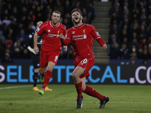 Liverpool's English midfielder Adam Lallana celebrates scoring their first goal as Liverpool's English striker Rickie Lambert reacts behind during the English Premier League football match between Leicester City and Liverpool at King Power Stadium in Leic