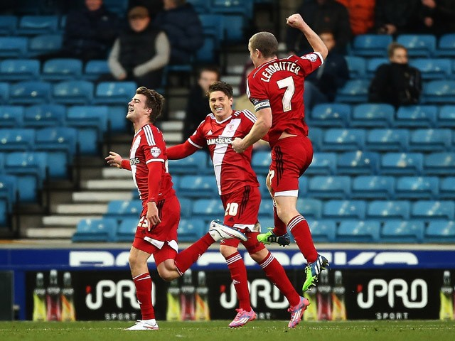 Middlesbrough celebrate with Patrick Bamford after he scores to make it 2-0 during the Sky Bet Championship match between Millwall and Middlesbrough at The Den on December 6, 2014