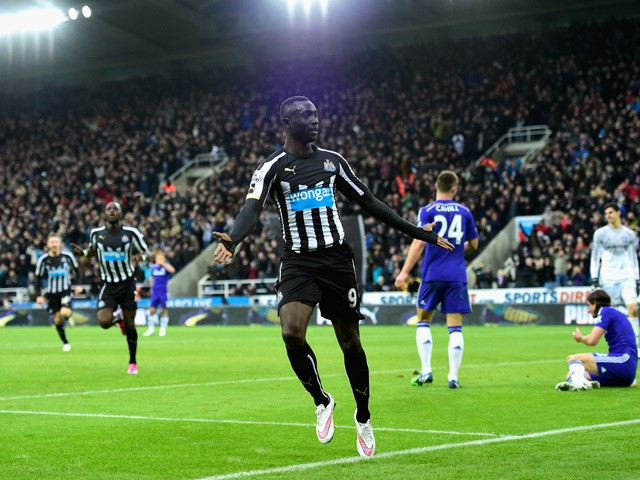 Papiss Cisse of Newcastle celebrates after scoring the second goal during the Barclays Premier League match between Newcastle United and Chelsea at St James' Park on December 6, 2014