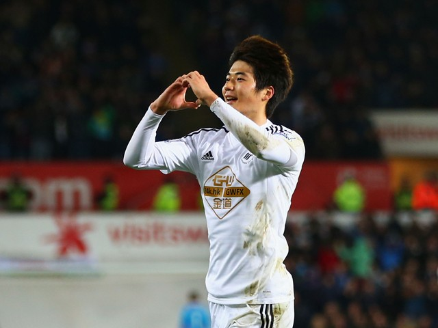 Ki Sung-Yueng of Swansea City celebrates as he scores their first goal during the Barclays Premier League match between Swansea City and Queens Park Rangers at Liberty Stadium on December 2, 2014