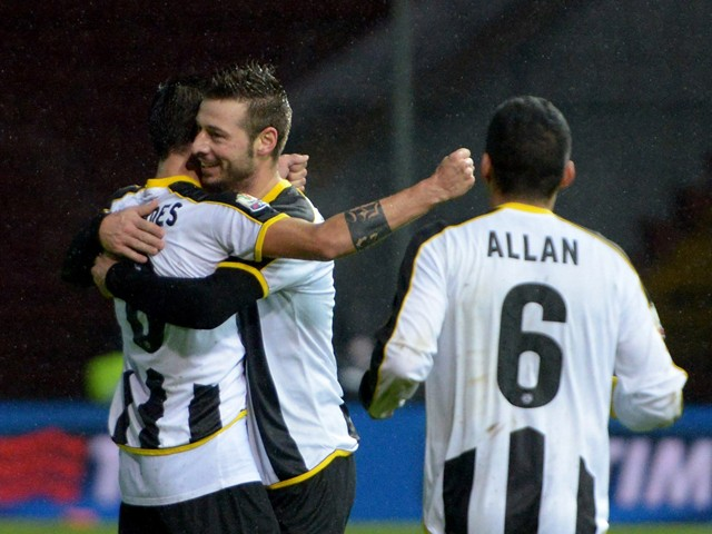 Bruno Fernandes Borges of Udinese Calcio is mobbed by team mates after scoring his team's second goal during the TIM Cup Match between Udinese Calcio and AC Cesena at Friuli Stadium on December 3, 2014