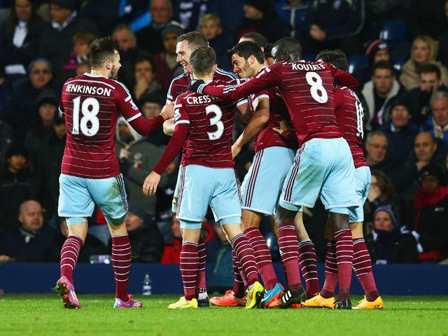 James Tomkins of West Ham United celebrates with team mates as he scores their second goal during the Barclays Premier League match between West Bromwich Albion and West Ham United at The Hawthorns on December 2, 2014