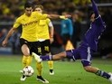 Dortmund's Armenian midfielder Henrikh Mkhitaryan (L) and Anderlecht's Anthony Vanden Borre vie for the ball during the second leg UEFA Champions League Group D football match on December 9, 2014