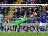 Manchester City's English goalkeeper Joe Hart dives to cover a direct free kick from Leicester City's Argentinian midfielder Esteban Cambiasso that goes wide during the English Premier League football match between Leicester City and Manchester City at Ki