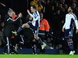 WBA player Craig Gardner celebrates his goal with manager Alan Irvine during the Barclays Premier League match between West Bromwich Albion and Aston Villa at The Hawthorns on December 13, 2014
