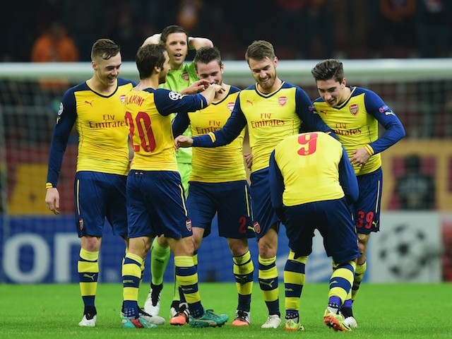 Aaron Ramsey of Arsenal (3R) celebrates with team mates as he scores their third goal during the UEFA Champions League Group D match against Galatasaray on December 9, 2014