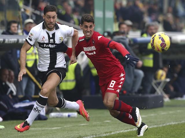 Andrea Rispoli of Parma FC competes for the ball with Danilo Fernando Avelar of Cagliari Calcio during the Serie A match on December 14, 2014