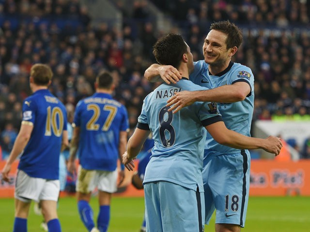 Frank Lampard of Manchester City celebrate Samir Nasri of Manchester City after scoring the opening goal during the Barclays Premier League match between Leicester City and Manchester City at The King Power Stadium on December 13, 2014