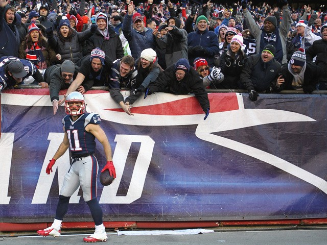 Julian Edelman #11 of the New England Patriots reacts after catching a touchdown pass during the third quarter against the Miami Dolphins at Gillette Stadium on December 14, 2014