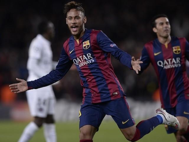 Barcelona's Brazilian forward Neymar da Silva Santos Junior celebrates his goal during the UEFA Champions League Group F football match against PSG on December 10, 2014