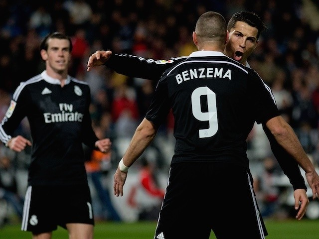 Gareth Bale, Karim Benzema and Cristiano Ronaldo celebrate Real Madrid's third goal during the La Liga match against Almeria on December 12, 2014