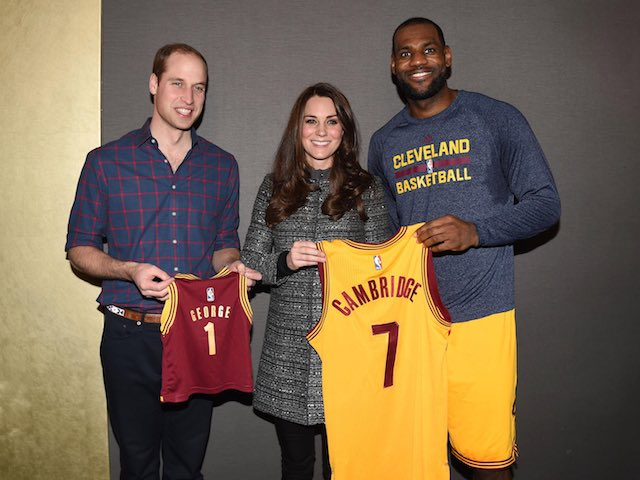Prince William, Duke of Cambridge and Catherine, Duchess of Cambridge pose with basketball player LeBron James (R) backstage as they attend the Cleveland Cavaliers vs. Brooklyn Nets game at Barclays Center on December 8, 2014