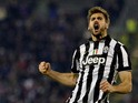 Juventus' forward from Spain Fernando Llorente celebrates after scoring during the Italian Serie A football match Cagliari vs Juventus on December 18, 2014