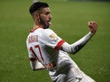 Monaco's Belgian midfielder Yannick Ferreira Carrasco reacts after scoring during the French League Cup football match Olympique Lyonnais against AS Monaco at the Gerland Stadium in Lyon, south-eastern France, on December 17, 2014