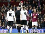 Referee shows the red card to Aston Villa's English striker Gabriel Agbonlahor (R) during the English Premier League football match between Aston Villa and Manchester United at Villa Park i