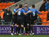 Matt Ritchie of AFC Bournemouth celebrates his goal with team mates during the Sky Bet Championship match between Blackpool and Bournemouth at Bloomfield Road on December 20, 2014