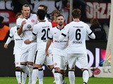 Frankfurt's midfielder Alexander Meier celebrates with teammates after scoring during German