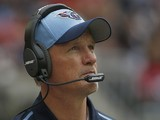 Head coach Ken Whisenhunt of the Tennessee Titans walks the sidelines while coaching against the Houston Texans in the third quarter in a NFL game on November 30, 2014
