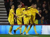 Raheem Sterling of Liverpool celebrates scoring his team's third goal with team mates during the Capital One Cup Quarter-Final match between Bournemouth and Liverpool at