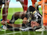 Steven Taylor of Newcastle United lies on the ground injured after colliding with the post during the Barclays Premier League match between Newcastle Unit