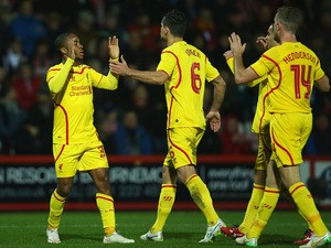 Raheem Sterling of Liverpool celebrates scoring the opening goal during the Capital One Cup Quarter-Final match between Bournemouth and Liverpool at Goldsands Stadium on December 17, 2014