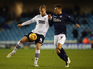 Matt Mills of Bolton Wanderers is challenged by Lee Gregory of Millwall during the Sky Bet Championship match on December 19, 2014
