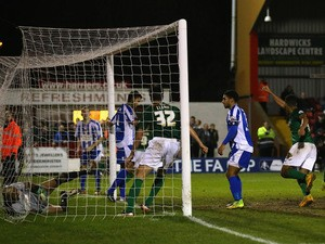 Ellis Deeney of Worcester City looks on as the players of Scunthorpe United celebrate the opening goal during the FA Cup Second Round Replay match between Worcester City and Scunthorpe United at Aggborough Stadium on December 17, 2014