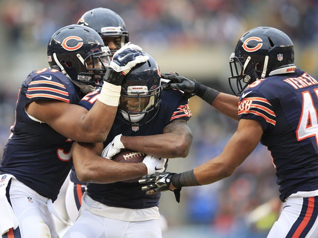 Ryan Mundy #21 of the Chicago Bears celebrates his interception with Jon Bostic #57, Christian Jones #59 and Brock Vereen #45 of the Chicago Bears during the second quarter of their game against the Detroit Lions at Soldier Field on December 21, 2014