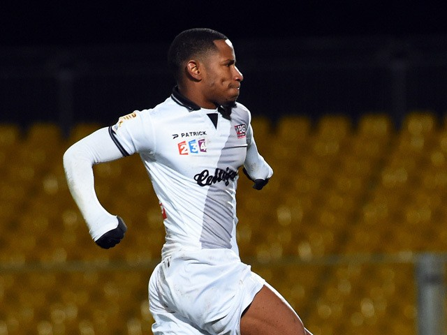 Guingamp's French midfielder Claudio Beauvue celebrates after scoring during the French League Cup football match Arles-Avignon vs Guigamp, on December 17, 2014