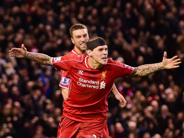 Liverpool's Slovakian defender Martin Skrtel celebrates scoring his team's second equalising goal during the English Premier League football match between Liverpool and Arsenal at Anfield in Liverpool, Northwest England, on December 21, 2014