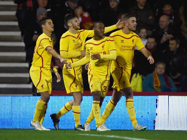 Raheem Sterling of Liverpool celebrates scoring his team's third goal with team mates during the Capital One Cup Quarter-Final match between Bournemouth and Liverpool at Goldsands Stadium on December 17, 2014