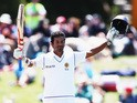 Dimuth Karunaratne of Sri Lanka celebrates after scoring a century during day three of the First Test match between New Zealand and Sri Lanka at Hagley Oval on December 28, 2014