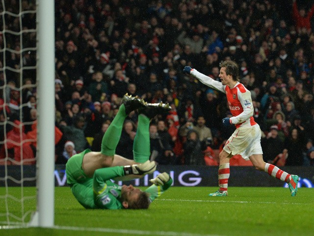 Arsenal's Czech midfielder Tomas Rosicky celebrates scoring their second goal during the English Premier League football match between Arsenal and Queens Park Rangers at the Emirates Stadium in London on December 26, 2014