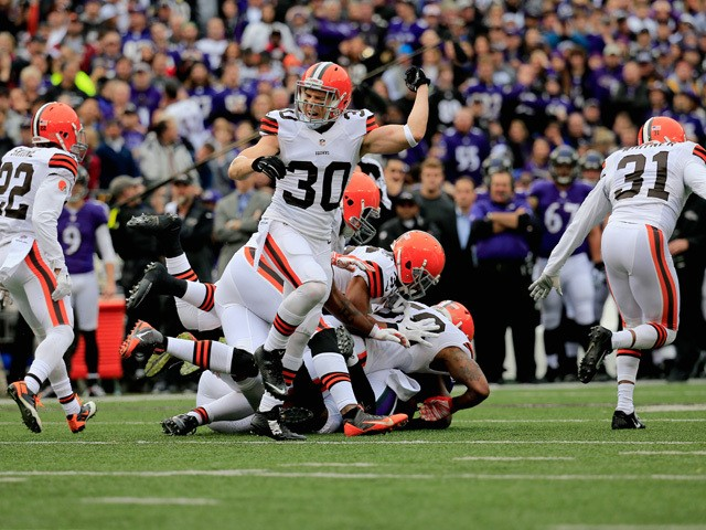 Free safety Jim Leonhard #30 of the Cleveland Browns celebrates after stopping the Baltimore Ravens on 4th down in the first quarter at M&T Bank Stadium on December 28, 2014