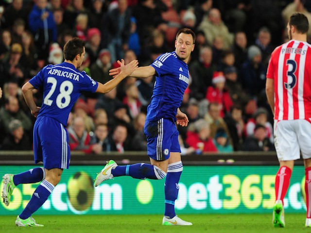 Chelsea player John Terry (c) celebrates after scoring the opening goal during the Barclays Premier League match against Stoke City on December 22, 2014