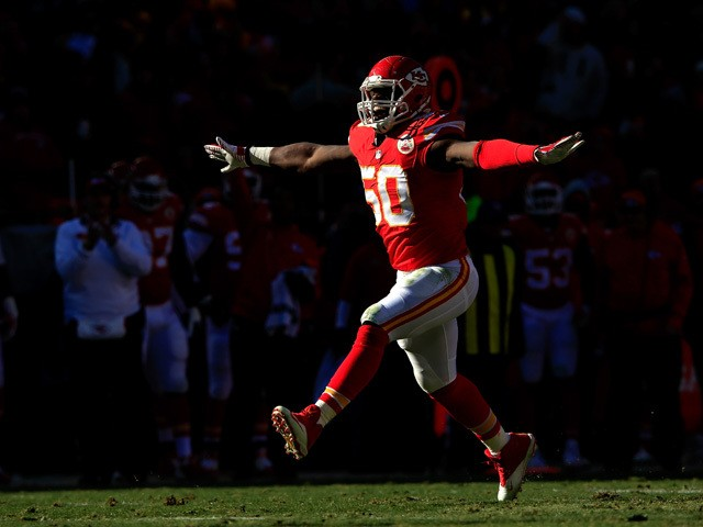 Outside linebacker Justin Houston #50 of the Kansas City Chiefs reacts after making a sack during the first half of the game against the San Diego Chargers at Arrowhead Stadium on December 28, 2014