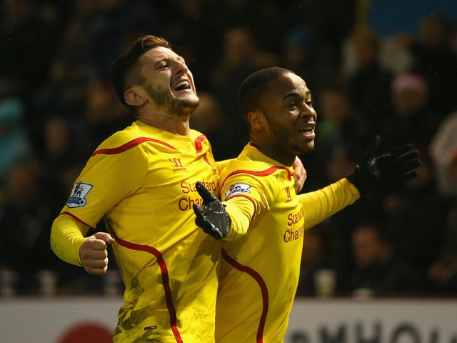 Raheem Sterling of Liverpool celebrates scoring the opening goal with Adam Lallana during the Barclays Premier League match between Burnley and Liverpool at Turf Moor on December 26, 2014
