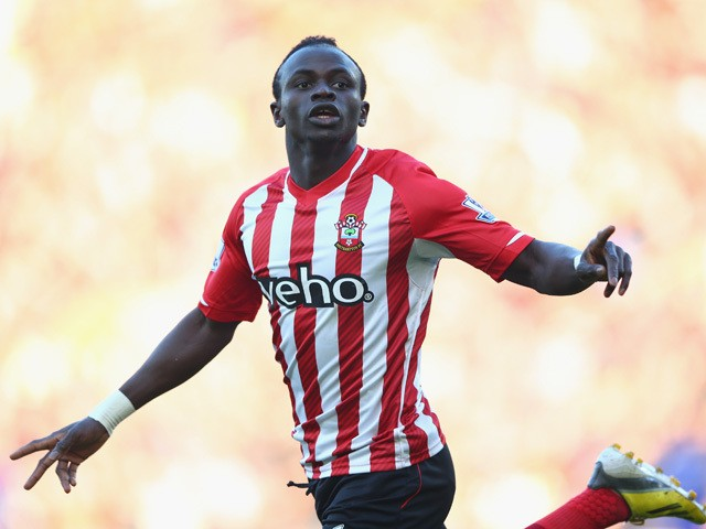Sadio Mane of Southampton celebrates scoring the opening goal during the Barclays Premier League match between Southampton and Chelsea at St Mary's Stadium on December 28, 2014