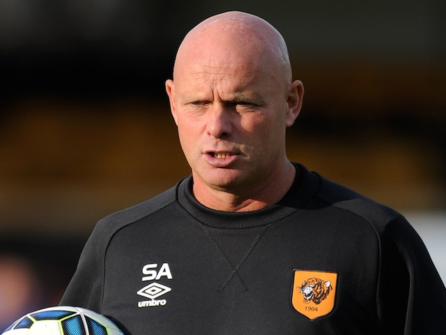 Steve Agnew, assistant manager of Hull City watches the warm up during a pre-season friendly between Harrogate Town and Hull City at the CNG Stadium on July 21, 2014