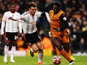Scott Parker of Fulham challenges Bakary Sako of Wolverhampton Wanderers during the FA Cup Third Round match on January 3, 2015