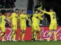 Villarreal players celebrate their first goal during the Spanish league football match Elche FC vs Villarreal CFat the Martinez Valero stadium in Elche on January 3, 2015