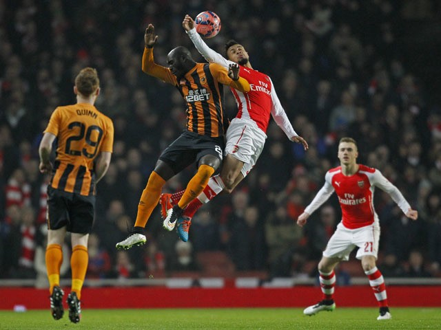 Hull City's Ivorian striker Yannick Sagbo vies with Arsenals French midfielder Francis Coquelin during the English FA Cup third round football match between Arsenal and Hull City at the Emirates Stadium in London on January 4, 2015