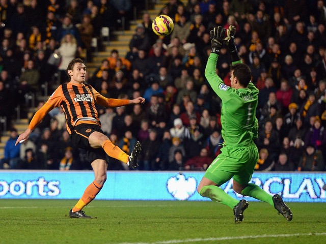 Nikica Jelavic of Hull City touches the ball over Joel Robles of Everton for his team's second goal during the Barclays Premier League match between Hull City and Everton at KC Stadium on January 1, 2015
