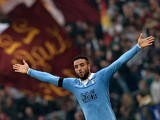 Lazio's midfielder from Brazil Felipe Anderson celebrates after scoring during the Italian Serie A football match AS Roma vs Lazio at the Olympic stadium on January 11, 2015
