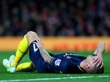 Toby Alderweireld of Southampton reacts after picking up an injury during the Barclays Premier League match between Manchester United and Southampton at Old Trafford on January 11, 2015